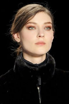 THE BEST MAKEUP LOOKS FROM FALL 2013: Orangey Shadow - At J. Mendel (left), makeup artist Gucci Westman, working with Revlon, blended a glossy coppery shadow just past the crease.