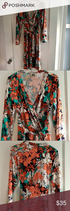 Anne Klein wrap dress!! So pretty light Anne Klein wrap dress! I love the flower pattern and the amazing wrap style!! Measures 37 inches in length, bust 18 inches, and waist measures 16 inches. 95% polyester 5% elastane Anne Klein Dresses Midi