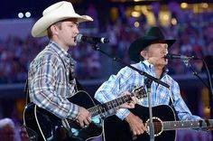 Musician George Strait (R) and his son Bubba Strait perform onstage at George Strait's 'The Cowboy Rides Away Tour' final stop at AT&T Stadium at AT&T Stadium on June 2014 in Arlington, Texas. Country Music Lyrics, Country Music Stars, Country Music Singers, Country Musicians, Country Artists, Strait Music, George Strait Family, I Love Music, King George
