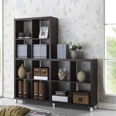 Our Sunna Designer Shelving Unit is a 12 cube-based modern bookshelf made of dark brown faux wood grain paper veneer over a frame of engineered wood. Silver plastic legs with non-marking feet complete this Malaysian-made modern display unit.