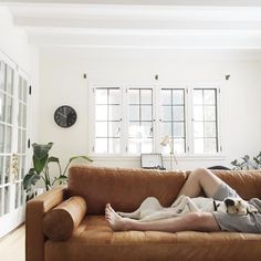 this light brown, leather -looking couch is exactly what I am looking for for the basement