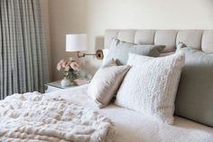 A soft color palette covers Caitlin Moran's Northern California bedroom, from the upholstered headboard to the pastel throw pillows.