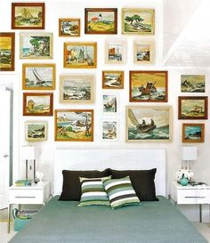 Vintage nautical art gallery wall: http://www.completely-coastal.com/2013/03/beach-bedrooms.html
