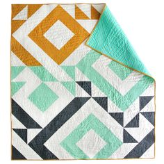 This striking, minimal pattern is perfect the newbie quilter. By using only one quilt block, the half square triangle, and rotating it different directions, a beautiful abstract composition is created. OVERVIEW • 100% original pattern • Skill Level: Easy • Downloadable PDF • Includes instructions for a Twin, Throw and Baby Quilt • Minimal, modern design • The perfect quilt for a beginner • Hate math? This pattern includes a cheat sheet chart to help you make it any size! • The perfect gender…