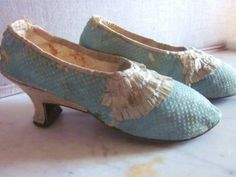 Pair of women's shoes, France, 1750-1780. Blue silk satin, cream silk ribbon trim in three rows, interior covered with cream kid.