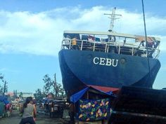 A ship washed ashore in Tacloban, Leyte now occupied by homeless residents in the aftermath of Typhoon Haiyan #YolandaPH. #Recovery #Relief #ReliefPH