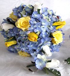 Bridal bouquets blue hydrangea white rose buds open closed yellow roses 4 piece wedding bouquet and boutonniere package. $82.00, via Etsy.