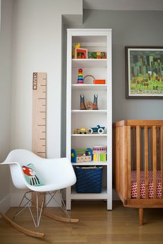 White Rocking Chair and Perfectly Styled Bookcase - #nursery | projectnursery.com