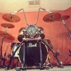 Biker drum set - great frame for the Pearl kick drum, surrounded by cymbals - and with ape hanger handlebars! #MOTORCYCLE #MUSIC #HUMOR PICS - https://www.pinterest.com/claxtonw/humor-pics/ - and a fun place to play! Photo pinned via Mary Martin, from Facebook BIKER OR NOT photos.