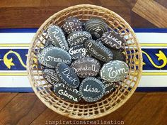 Clever way to set placecards. Personalized stones on the table and a cute take home.  Maybe write inspirational words on the back of the stones...faith, hope, love, etc.