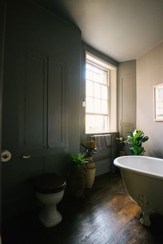 A dark and thoughtful place to relax, in the foliage. The walls are painted in Farrow & Ball's 'Moles Breath', a little darker and richer than the hallway, perfect for soothing the soul while having a warm bath.