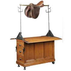 Late C19th Pitch Pine Saddle Horse, by Musgrave & Co Ltd  A Saddle Horse is used for cleaning, storing and repairing horse tack. The ironwork firm Musgrave & Co.  founded in Belfast 1843 . They fitted and furnished stables for members of the European royalty and aristocracy, including Victoria, The Princess Royal, Empress of Germany and Alfonso XIII of Spain, as well as cattle barons in South America