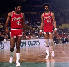 Scott May (No. 42) and Artis Gilmore walk onto the court during a 1976 Celtics-Bulls game