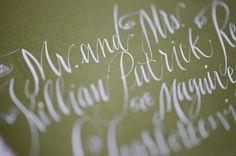 I love the white calligraphy.  Elegant Springtime Wedding Ideas