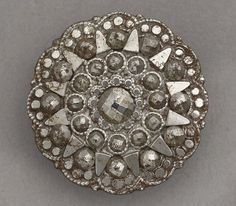 Cut steel coat button made in Birmingham around 1800.