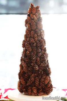 This stunning do-it-yourself pinecone tree makes a fantastic centerpiece for your holiday celebrations.