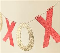 Valentine's Day party decor: hang a string of glitter XO letters! #vday #decor #DIY