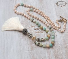 BOHO CHIC NECKLACE, Silk Tassel Necklace , Amazonite Tassel Necklace, Boho chic , Statement Necklace, Gift for Her A Unique , beautiful, hand knotted long Tassel Necklace . Features antique rhinestones ivory opac crystal beads , Amazonite and aquamarine gemstones , a rhinestones