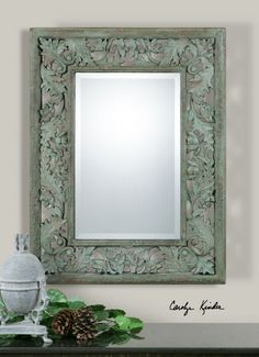 "Soana mirror.  ornate leaf design and finished in aged, mossy green with a light gray wash and rust undertones.  1 1/4"" bevel."