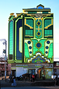 """vintagegeekculture:""""The single greatest and most fascinating """"futurist"""" architecture movement in the world right now is happening in Bolivia, where national prosperity and a dedication to works for the poor and public housing led to an explosion of. Architecture Photo, Amazing Architecture, Contemporary Architecture, Cinema Architecture, Art Nouveau, Art Deco Buildings, Amazing Buildings, World, Indigenous Art"""