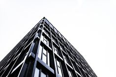 The commercial property buying process is an altogether different beast compared to other kinds of real estate purchases. This is an important business investment. Living Room Modern, Rugs In Living Room, Room Rugs, Tower Block, Concrete Building, Relaxation Room, Monochrome Photography, Commercial Real Estate, Living Room Lighting