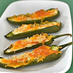 "Baked Jalapeno Poppers | ""Jalapenos are stuffed with Cheddar cheese and cream cheese, with bread crumbs for a crunch. Baked to keep them healthier than the fried ones!"""