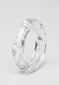 Sobral cuff made of clear and silver-colored natural light weight resin. Hand made.Brazilian designer Carlos Sobral,