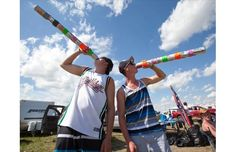 """Brad Tomm, 18, left, and Christian Diakiw, 18, drink from their """"wizard staffs"""" on the festival campgrounds at the Big Valley Jamboree in Camrose on Aug. 5, 2012."""
