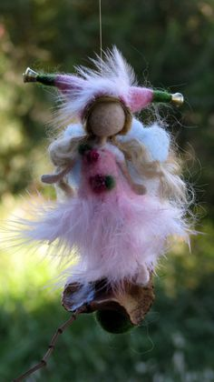 Needle felted Waldorf inspired Mobile Ornament Little magic fairy on a seed with feather dress