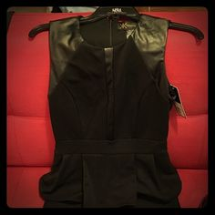 Kardashian kollection black leather dress New with tags! Black dress with leather accent designs. Never worn. Kardashian Kollection Dresses Midi