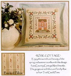 Rose Cottage - Cross Stitch Pattern.  Finishing idea for a pillow in which the cross-stitch is changed - button corners made of same coordinating fabric that forms the back of pillow.