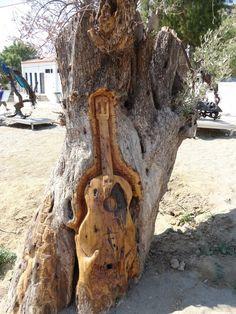 Guitar Tree in Matala, Greece Via https://www.crete-car-rentals.gr/