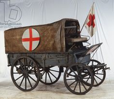 World War I ambulance with red cross flag.