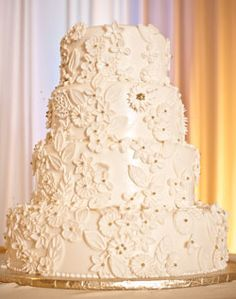 White wedding cake with butter cream flowers.