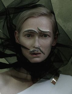 Editorial detail of Tilda Swinton in Stranger than Paradise photographed by Tim Walker for W May 2013  Though they may look as if they were mechanically placed, we waited hours for these centipedes to crawl into their meaningful positions, decking me out with eyebrows and mustaches. Ceci nest pas une moustache, as Magritte might have put it. -Tilda Swinton