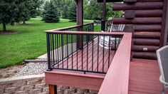 Azek redland rose decking, Westbury black fine texture aluminum railing with round balusters and their drink rail adapter Staircase Railings, Deck Railings, Deck Repair, Deck Colors, Outdoor Ideas, Outdoor Decor, Outdoor Living, Porch, New Homes
