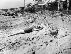 A woman sunbathes on a wartime bank holiday surrounded by barbed wire on the beach at Bournemouth, August (Photo by Topical Press Agency/Hulton Archive/Getty Images) Bournemouth England, Bournemouth Beach, Vintage Beach Photos, Vintage Pictures, August Bank Holiday, England Beaches, Barbed Wire, The Bikini, Historia
