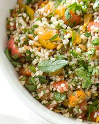 """Nutty Brown-Rice Tabbouleh - """"Tabbouleh is a Middle Eastern salad typically made with bulgur (dried and ground or crushed wheat berries that are parboiled). Here, warm brown rice takes bulgur's place.""""  Recipe on Food & Wine"""