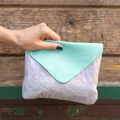 Learn how to make this simple, classic clutch with leather and hand marbled fabric