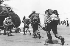 Marines of Battalion Landing Team board the aerial assault helicopters from the deck of the amphibious assault ship, USS Princeton during Operation OSAGE - April Vietnam Veterans, Vietnam War, Usmc, Marines, Military Pictures, Us Marine Corps, American Soldiers, Helicopters, Landing