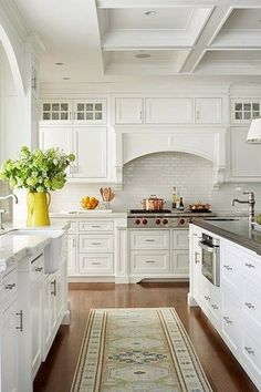"""Traditional Kitchen with Custom hood, Wolf 48"""" sealed burner rangetop - 6 burners and infrared griddle, Glass panel, L-shaped"""