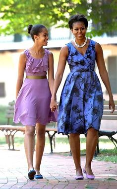 First Mom and First Daughter Malia....mom's shoes match Malia's dress....and Malia's shoes match mom's dress!