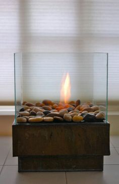 http://www.theartofdoingstuff.com/how-to-make-a-personal-fire-pit-for-cheap/.  Indoor or outdoor home made firpit for $25.