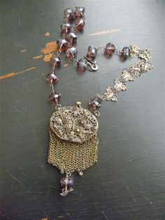 FLUTTER BY BUTTERFLY - Necklace with Faceted Quartz, Filigree Butterflies, and Victorian Purse with Butterfly from France. $250.00, via Etsy.