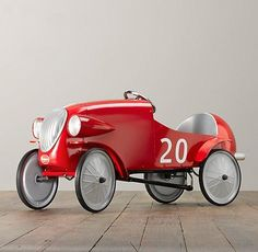 Le Mans Pedal Car, the dream of any 3-6 year-old kid (or maybe me) is inpsired by vintage European racing cars. Pedals adjust as the child grows. It's also available in gray or green, but why would anyone not want red?