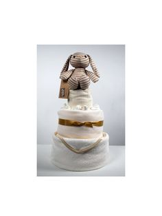 This 3 Tier cake includes:    1x Cream Plush (0+ years),  1x Hooded Baby Bath Towel,   1x Fleece blanket,  3x Feeding/ Muslin Cloths,   2x Pairs of Scratch Mits,  5x Pairs of socks,  50x Size 1 Pampers Nappies.