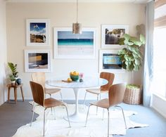 Bright dining room with tropical photos