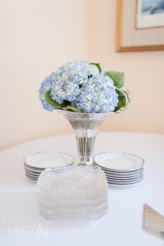 Cherry's Very Vintage Rentals perfectly styled this bridal shower located at San Francisco Yacht Club in Belvedere, CA. These table settings perfectly mix hydrangeas with old and new china for a fresh, fun look! Photography by Fancy Fig Photgoraphy