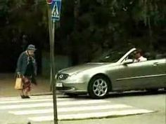 Don't honk at old people! A lady was videotaping her son riding a skate board when her attention switched to an old woman trying to cross the street. This old lady has spunk. and that guy's a dick