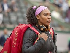 Serena Williams enters the court wearing her headphones before her match against Andrea Hlavackova on day three of the French Open.  Susan Mullane, USA TODAY Sports